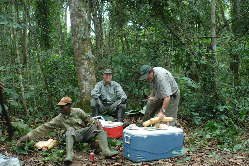 Lunch in the middle of the Gabonese rain forest. Stopping for regular small meals during the course of a hunt becomes more important as you grow older to help maintain energy and concentration levels.