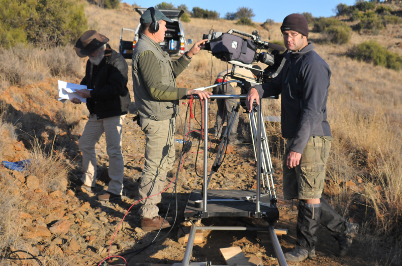 Shane Mahoney, the main narrator, Theo Pretorius, director/DOP and Justin Van Zyl, grip, preparing to film part of the documentary on the slopes of the Rooiberge (Red Mountains) on Bankfontein in the Karoo.