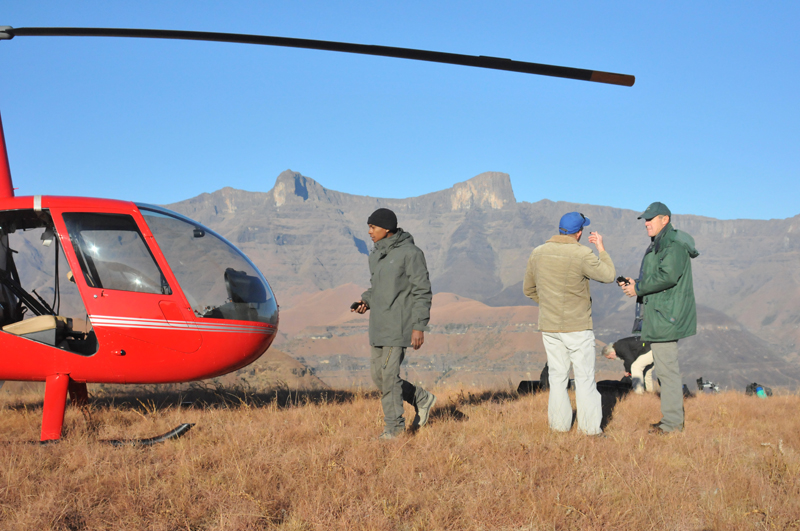 Jermain Beston, production manager, our pilot and Theo in the Drakensberg planning on how to fly our main narrator, Shane Mahoney, up to the top of the mountains in the background for one of the scenes in the documentary.