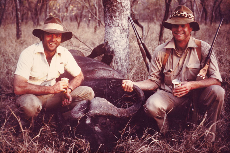 This is a photo of my very first buffalo, a young, soft-bossed bull, 32 inch bull that I would never have shot had I known then what I know now. But my useless professional hunter was insistent that I shoot it and I did not know any better. You can see the shoulder holster around my shoulders that held my Ruger Red hawk revolver with its seven inch barrel. The man with me in the photo is Derek Carstens who went on to become the head of marketing for the 2010 Soccer World Cup held in South Africa and remains a close friend.