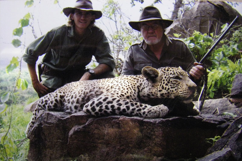 Ryan Cliffe posing with his client after having removed the leopard from the warthog burrow inside a cave where he found and shot the wounded cat.