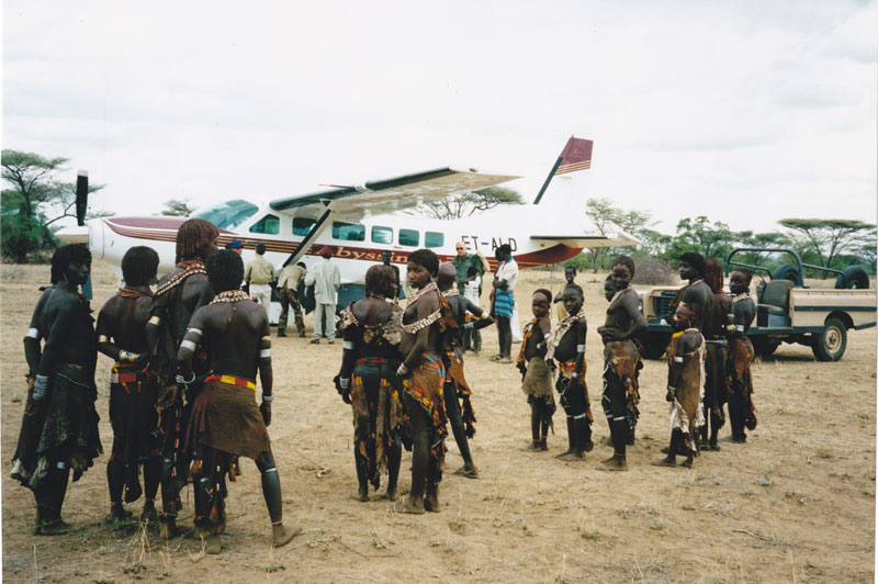 The regular welcoming committee of Hamar women and children at the dirt landing strip at Ethiopian Rift Valley Safari's Murulle Camp in Ethiopia's Omo Valley.