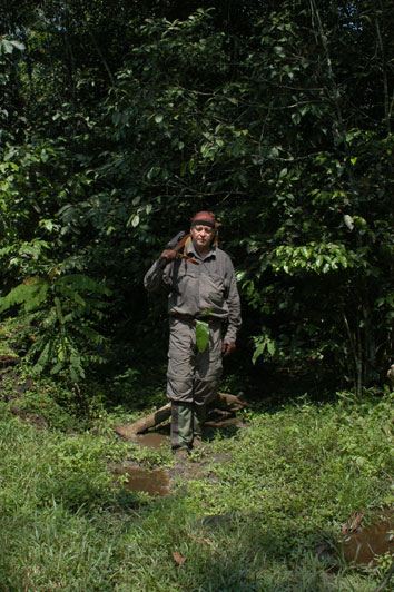 The author emerging from the rain forests of southeastern Cameroon while on a rain forest elephant hunt. The leaf tucked into his belt was given to him each morning by his pygmy trackers to keep him safe during the day and to make sure he shot straight.