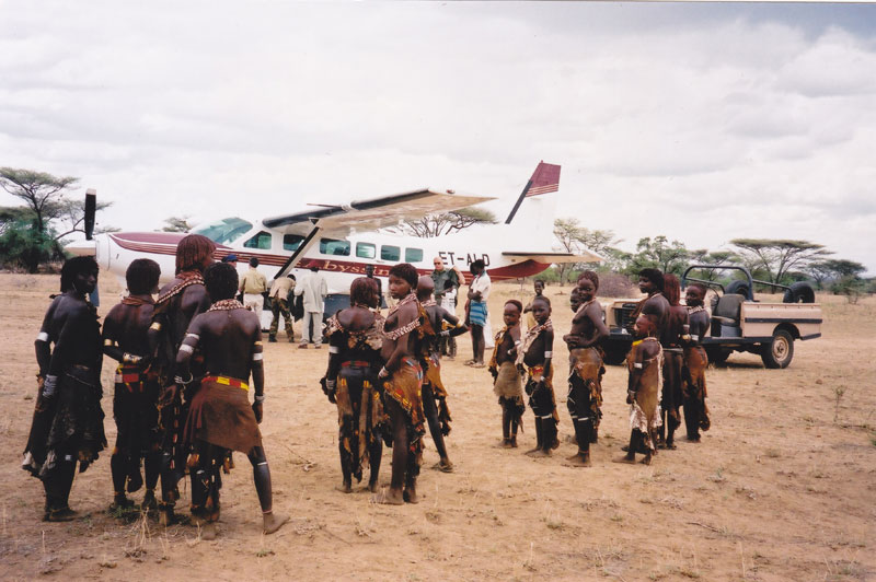 A group of Hamar women and children there to welcome my charter flight from Addis Ababa to the Murulle landing strip in the Omo Valley in southwestern Ethiopia. The trip takes 1 ½ hours by plane and two days by car.