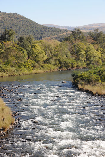 The Umkomaas River flowing in front of Aardnesgaard & Kennedy's comfortable Nkonka Camp in the Umkomaas Valley.