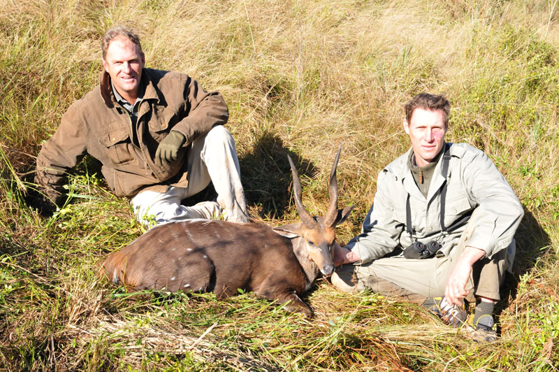 Dave Aardnesgaard and Pete Kennedy, partners in the safari outfitter of the same name, pose with The Donkey. Note the stripes on the animal, unusual markings for a South African or Cape bushbuck.