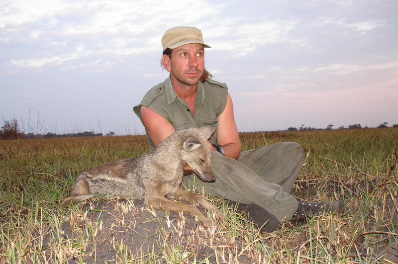 My PH, Schalk Tait, a degreed lawyer with 11 years of Tanzanian hunting experience behind him, holding up the side-striped jackal.