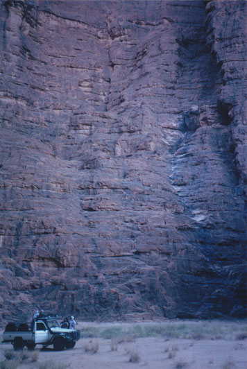 One of the near vertical rock massifs in the Ennedi Mountain range. The white markings on the rock show the path taken by the Barbary sheep when they climb back up after feeding on the sparse vegetation at the foot of the rock.