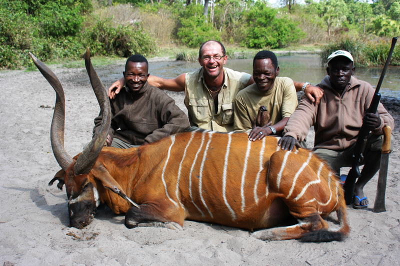 Rowland Ward's current number one bongo shot by Peter Flack and seen here with his hunting team - from left to right - Assan, Christophe, Luc and Deme.