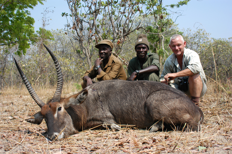 From left to right, our game guard, Zeiss and my PH, Andrew Baldry, pose next to a good representative Crawshay's waterbuck in the Lunga Lushwishi concession in Western Zambia. Zeiss, so nicknamed because of his incredible eyesight, could spot these animals in amongst the grey tree trunks fringing the dambos at distances that neither I nor Andrew could make out with our binoculars.