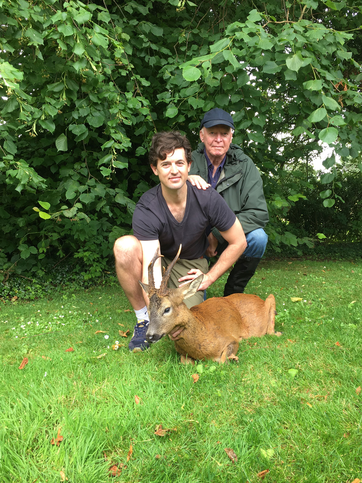 The author's Godson, Tyghe Carstens, and the author with the former's good quality, possible bronze medal roe deer buck